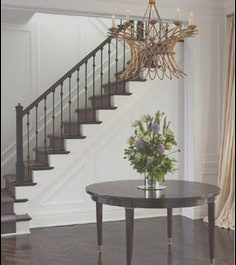 Entry Table by Stairs New Wainscoting Along Curved Stairs