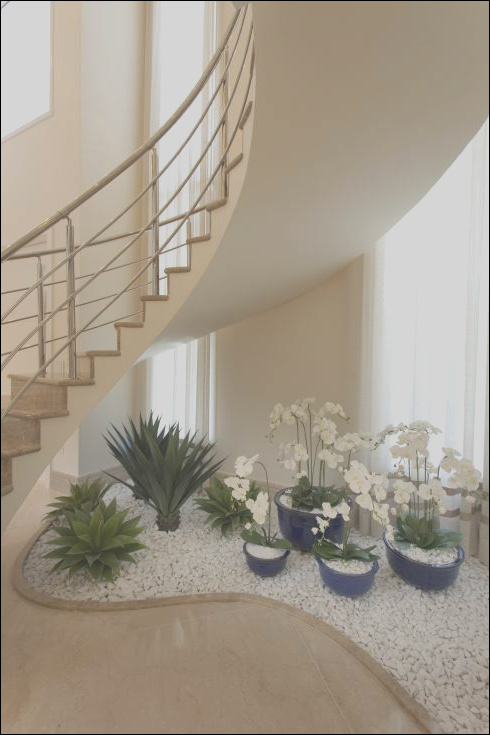 20 ideas to decorate around your stairs with pebbles and plants
