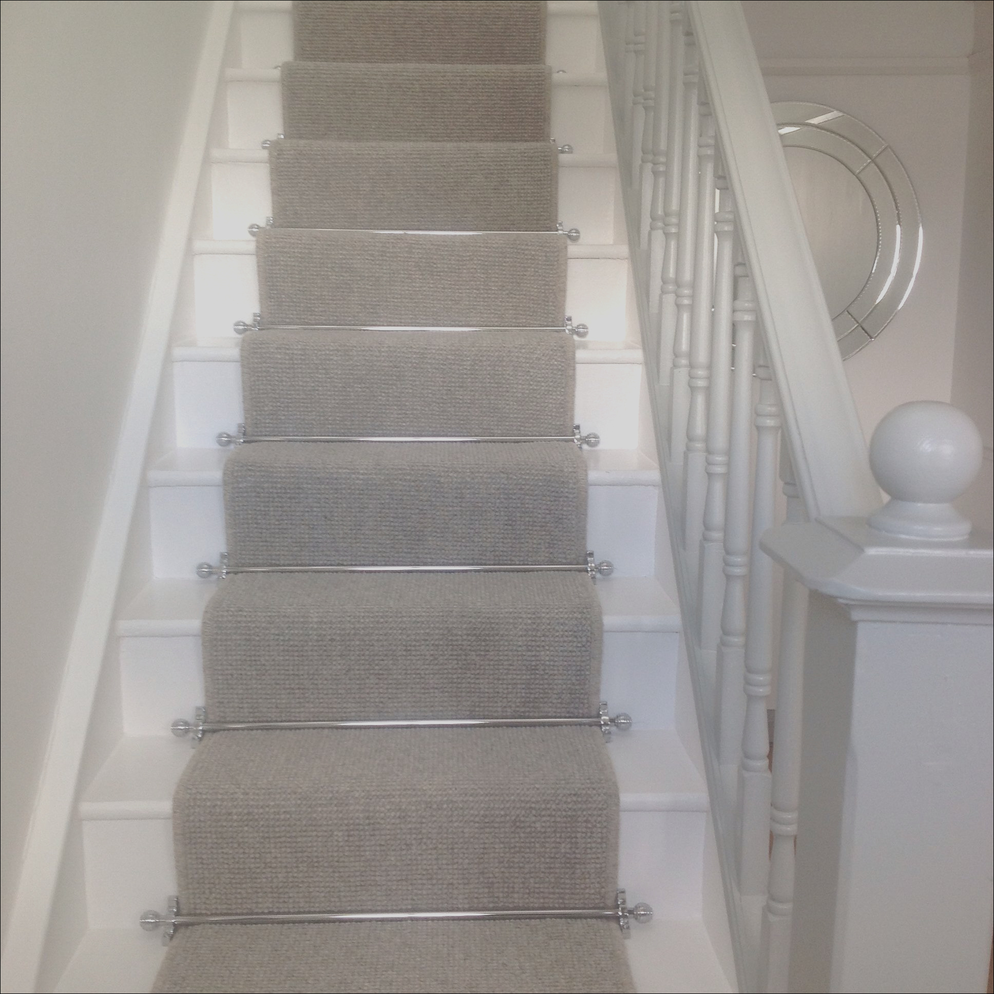 stairs with grey carpet