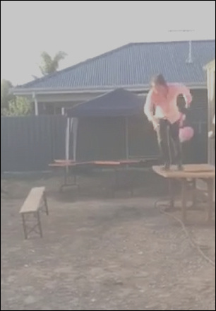 11 rustic guy jumps off stairs into table image