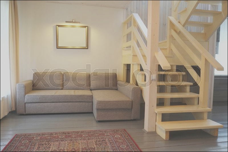 room with a sofa and stairs image