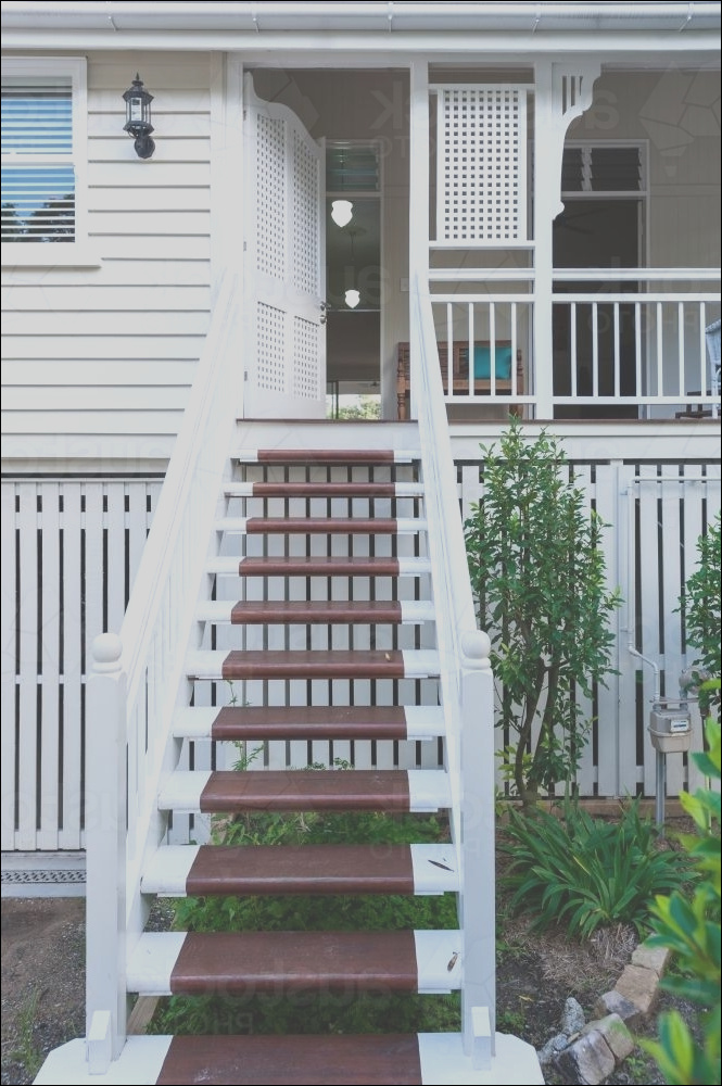 stairs on the front veranda of a queenslander home YoHqC