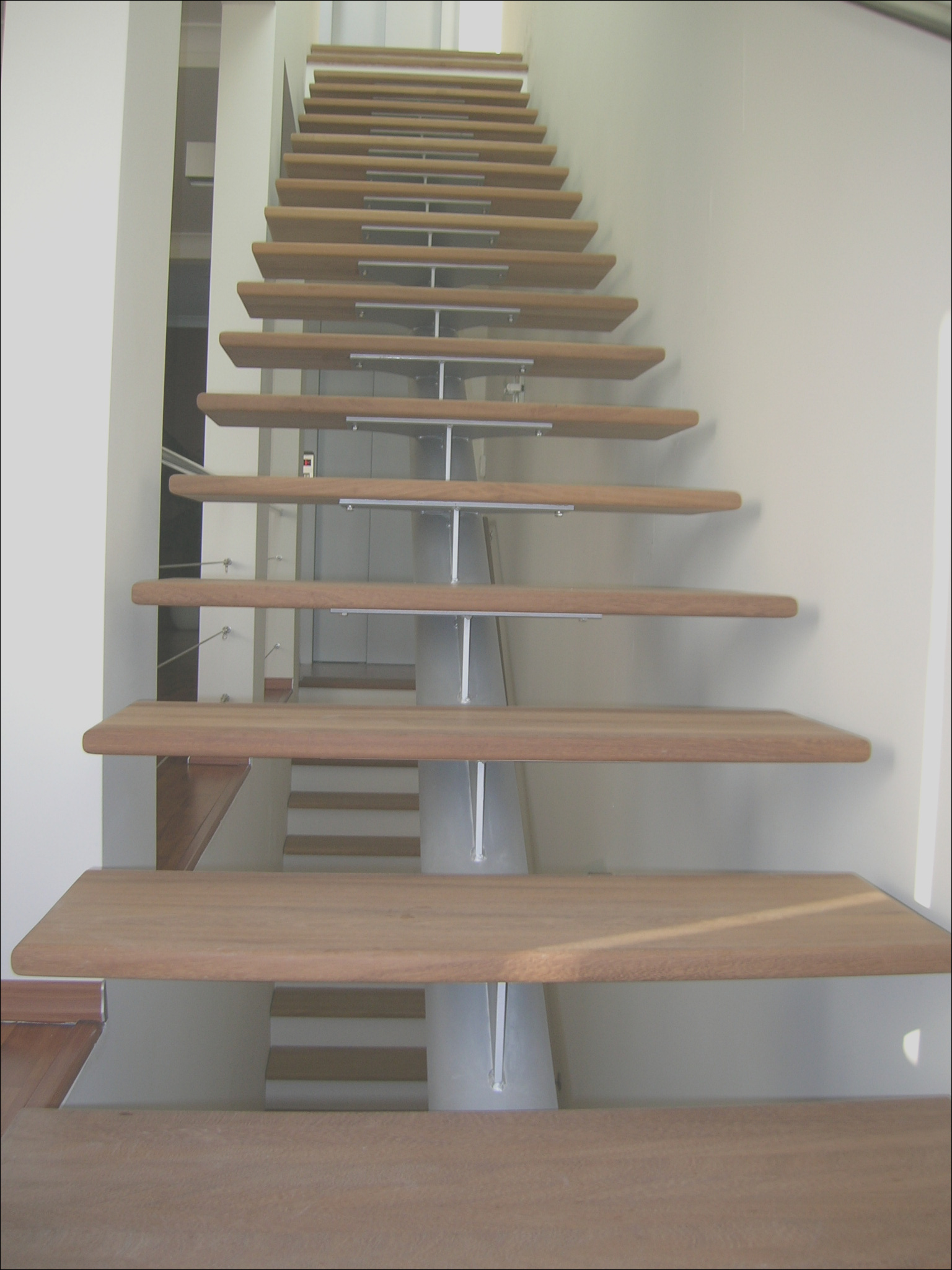 modern steel and wood indoor stairs