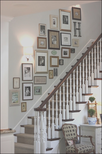 sunday showcase staircase gallery wall