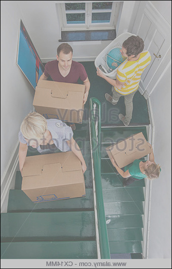 11 primary moving heavy furniture on stairs image