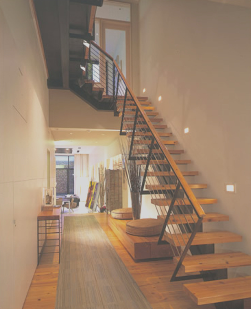 wooden front stairs corridor house flowing space