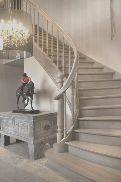 adore grey stairs lends a warmth and sophistication to any entryway chic wood glamerous