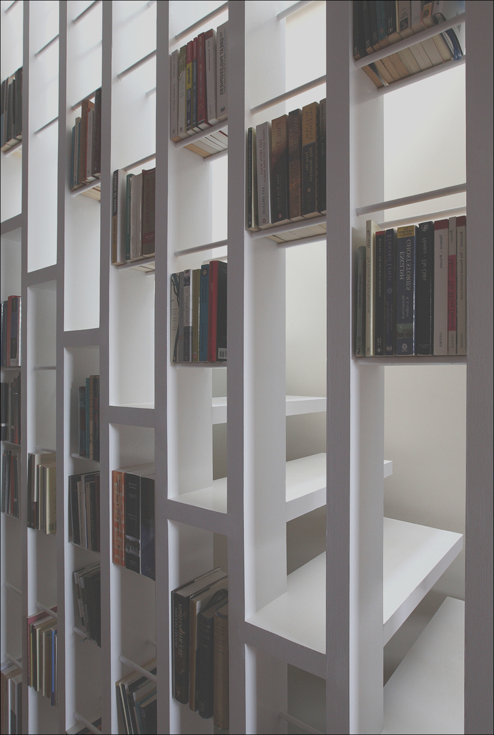a new staircase does double duty as a bookcase