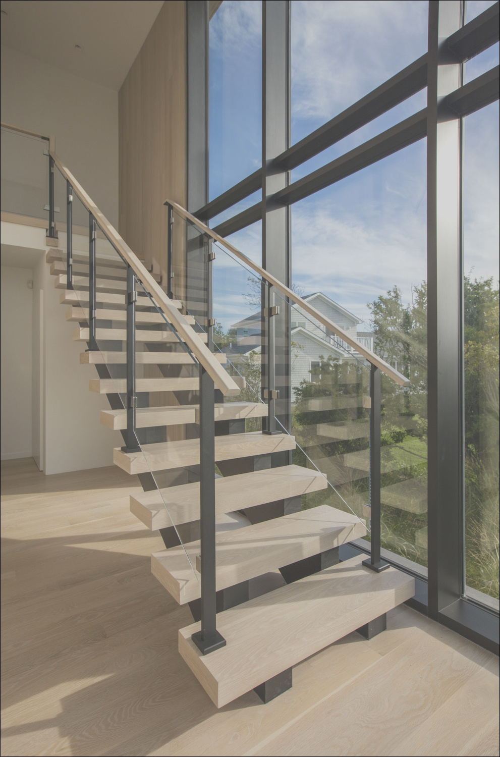 modern cable and glass staircase railing in montauk ny