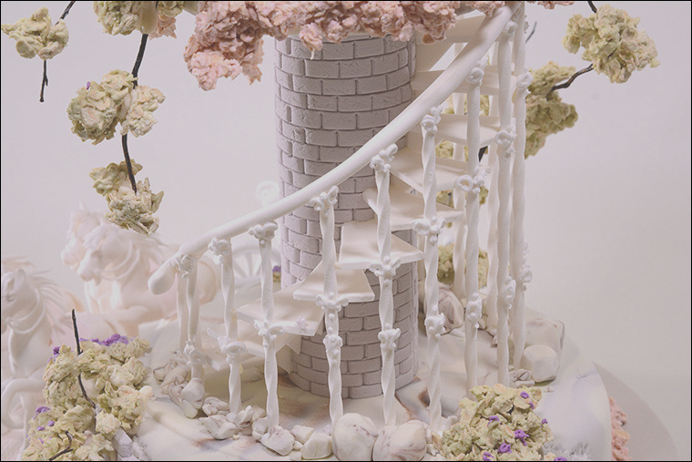 spiralling staircase and assembly of fairy tale wedding cake
