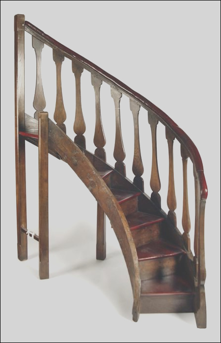 set of oak spiral library stairs