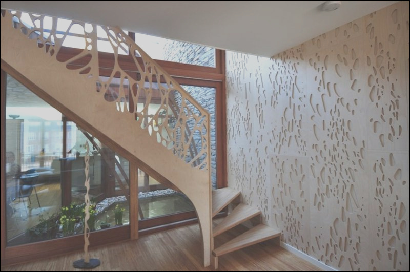 side stairs view of house with stylish wooden facade and stunning interior
