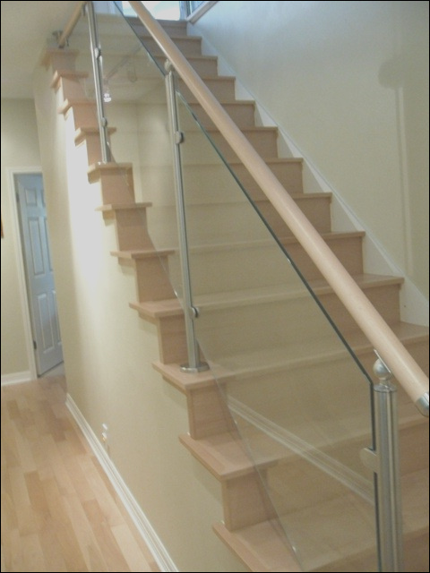 Wood Stairs and Stainless Steel Glass Railings contemporary staircase austin