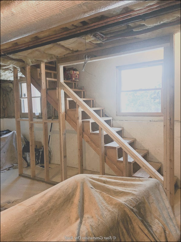 why we opened up our basement staircase and installed iron balusters