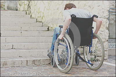 stock photo architectural barrier young man wheelchair who can t up stairs image