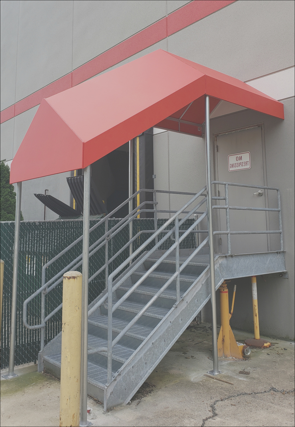 entrance canopy over stairs on a mercial building