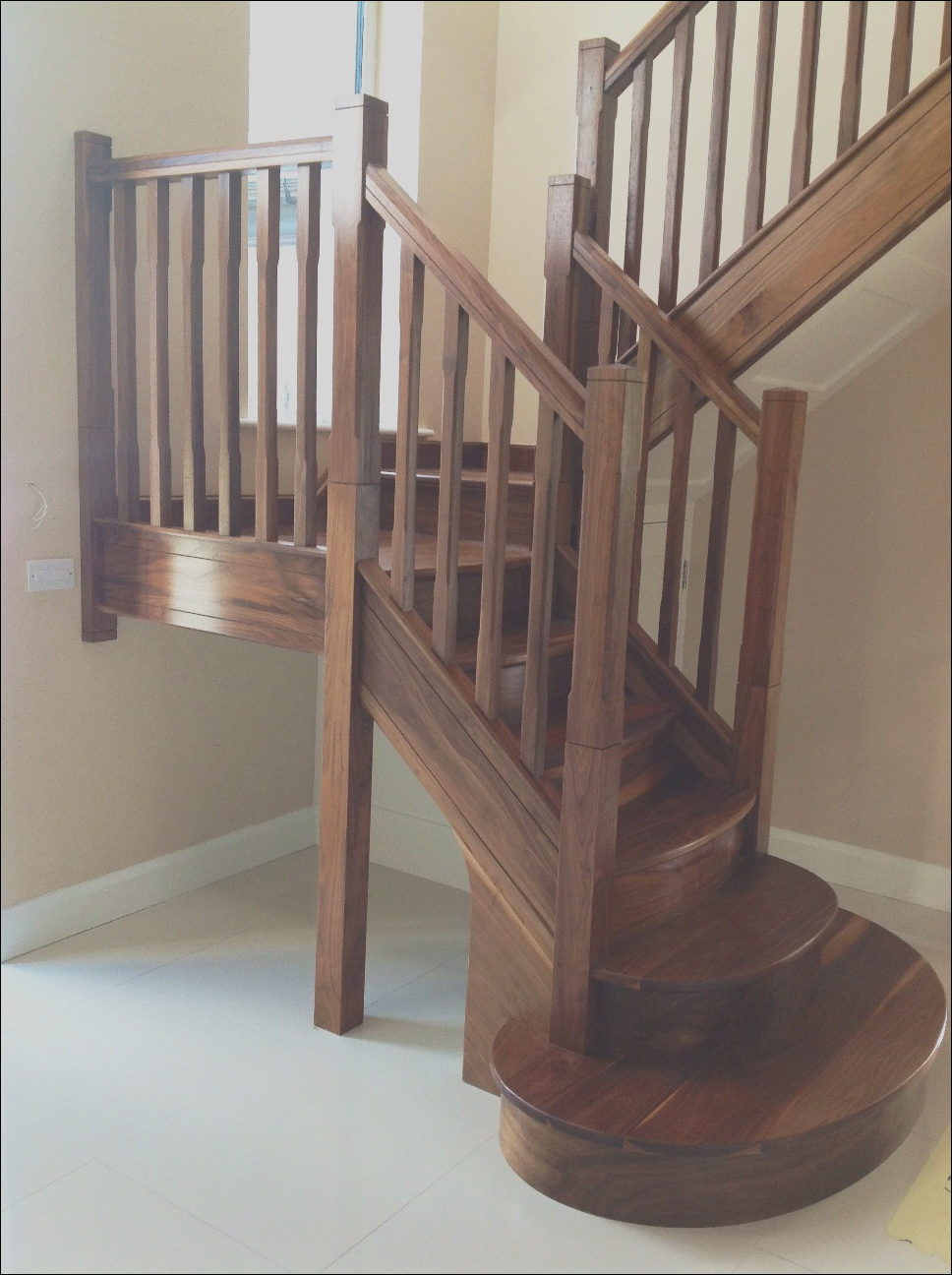contemporary solid walnut closed string timber stairs
