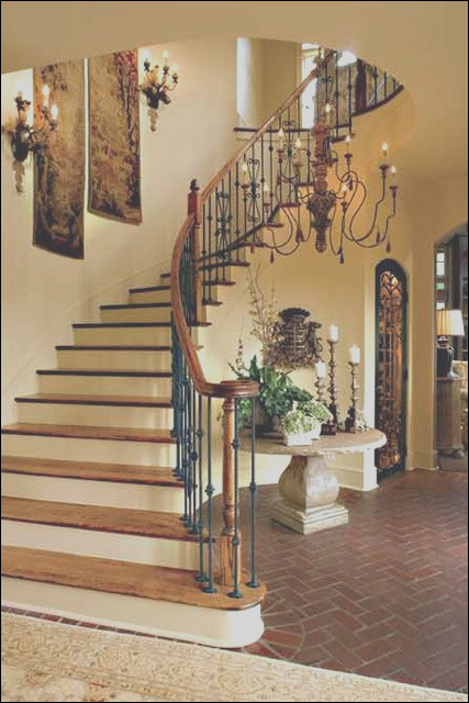 how to decorate a curved staircase wall