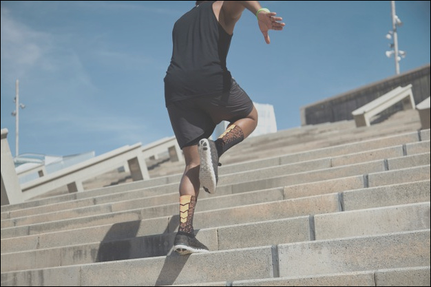 young man jumping stairs