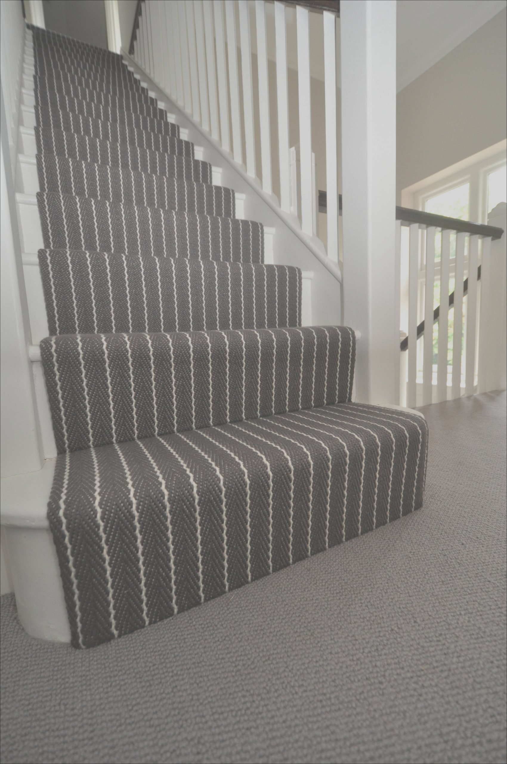 images of striped carpets on stairs