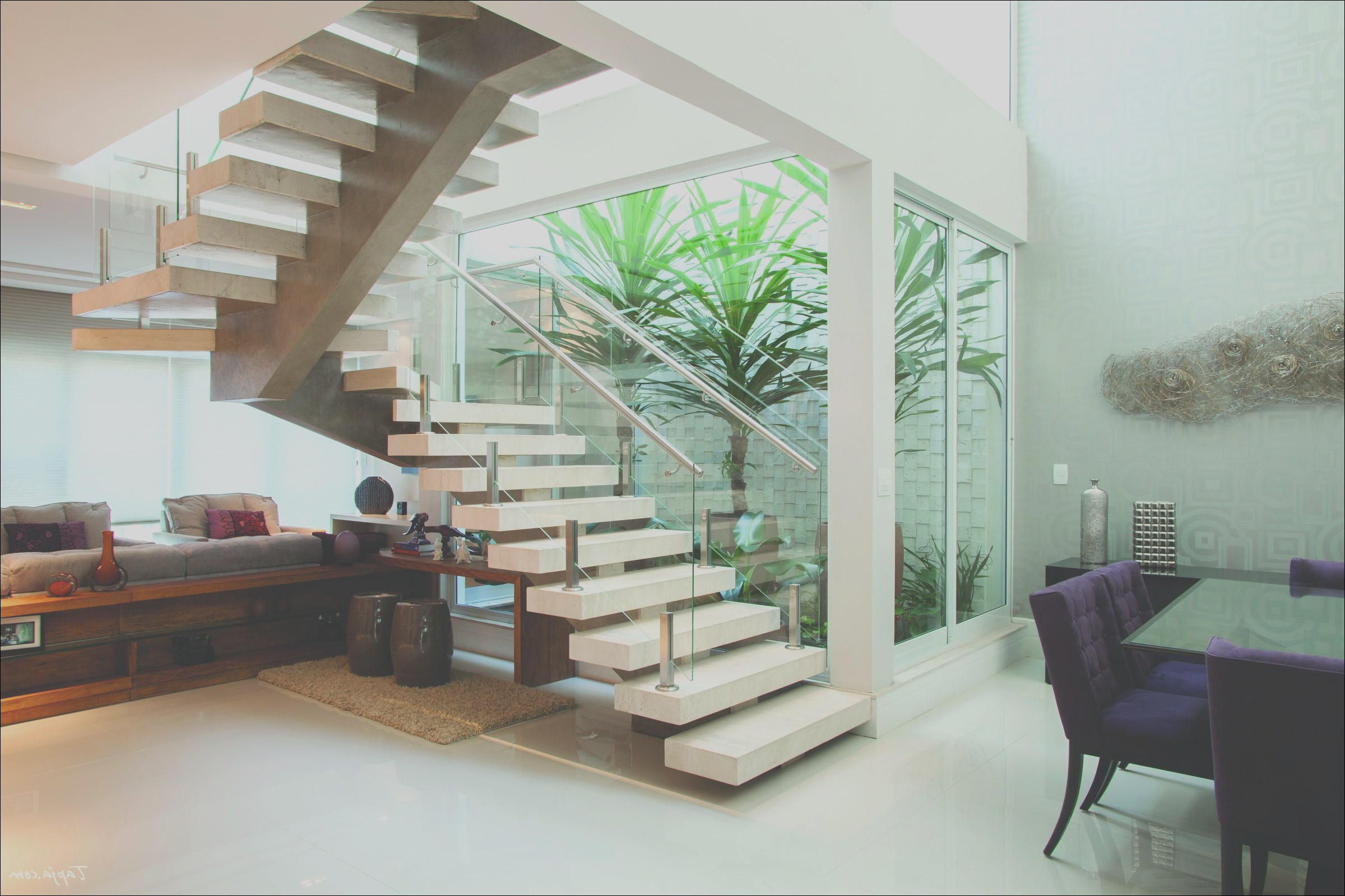 living room design under stairs contemporary apartment design with decorate a staircase beside small garden along with living room under stairs as well dining table set in the nearby