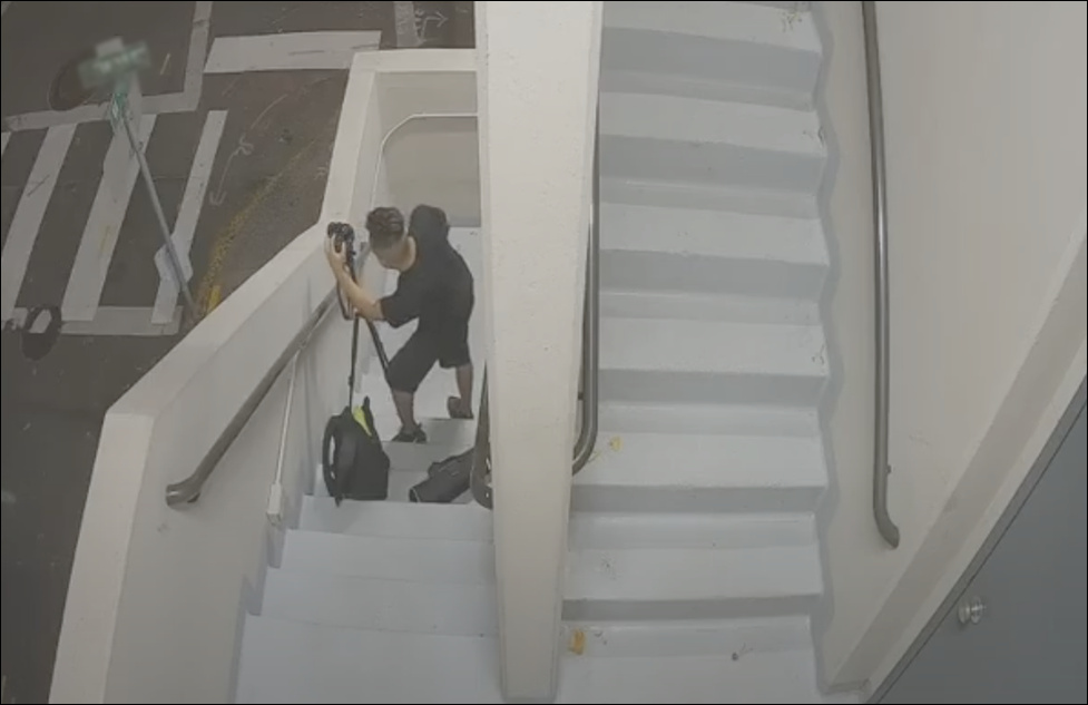 protest photographer loitering in parking garage stairs leaves after voicedown