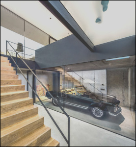 basement car garage with wood stairs