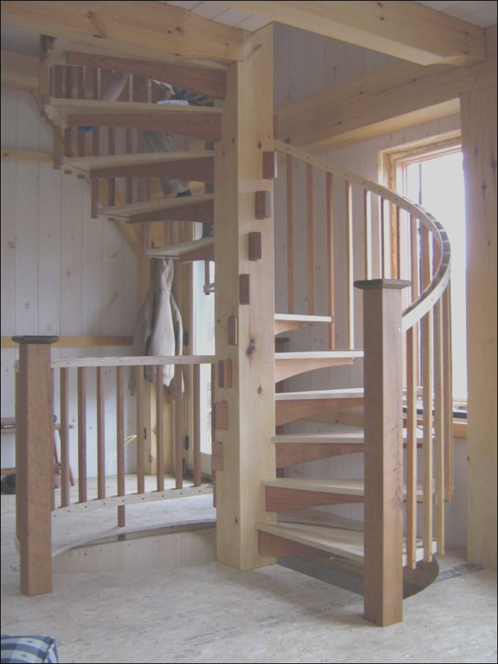 spiral stair in timber frame cabin