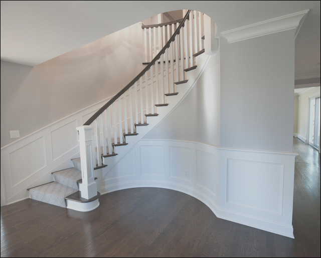 Curved Staircase and Wood Paneling transitional staircase new york