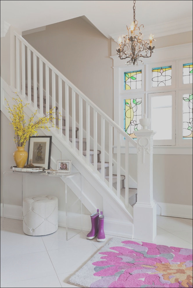 bright acrylic console table in staircase transitional with florida tile next to carpeted staircase alongside white stair railing andcarpet stairs