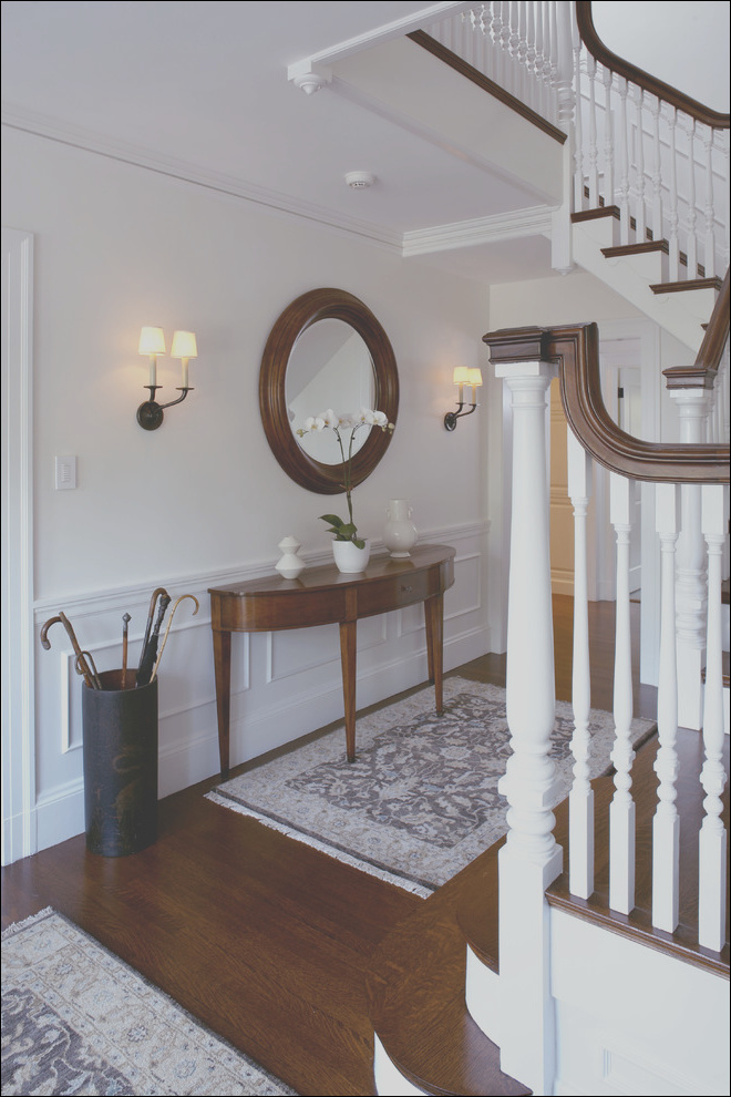 beautiful demilune table in staircase traditional with wall and trim color next to newel post alongside entry table andwhite dove